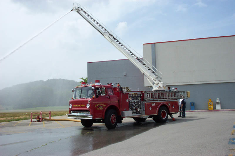 water spraying from fire engine ladder during ladder training