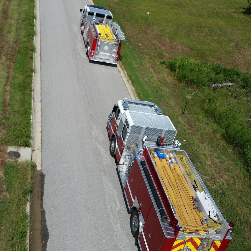 aerial view of two fire engines parked on the street