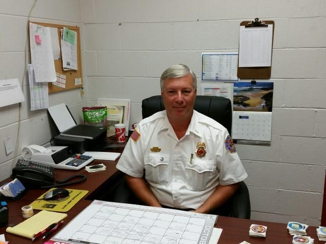Captain Gary Pyszka fire inspector sitting at his desk