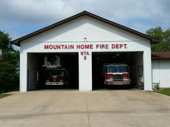 Mountain Home fire department station on Sunset Drive, with 2 fire trucks in the bays