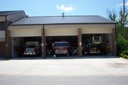 Mountain Home fire department station on South Hickory St, with 3 fire trucks in the bays